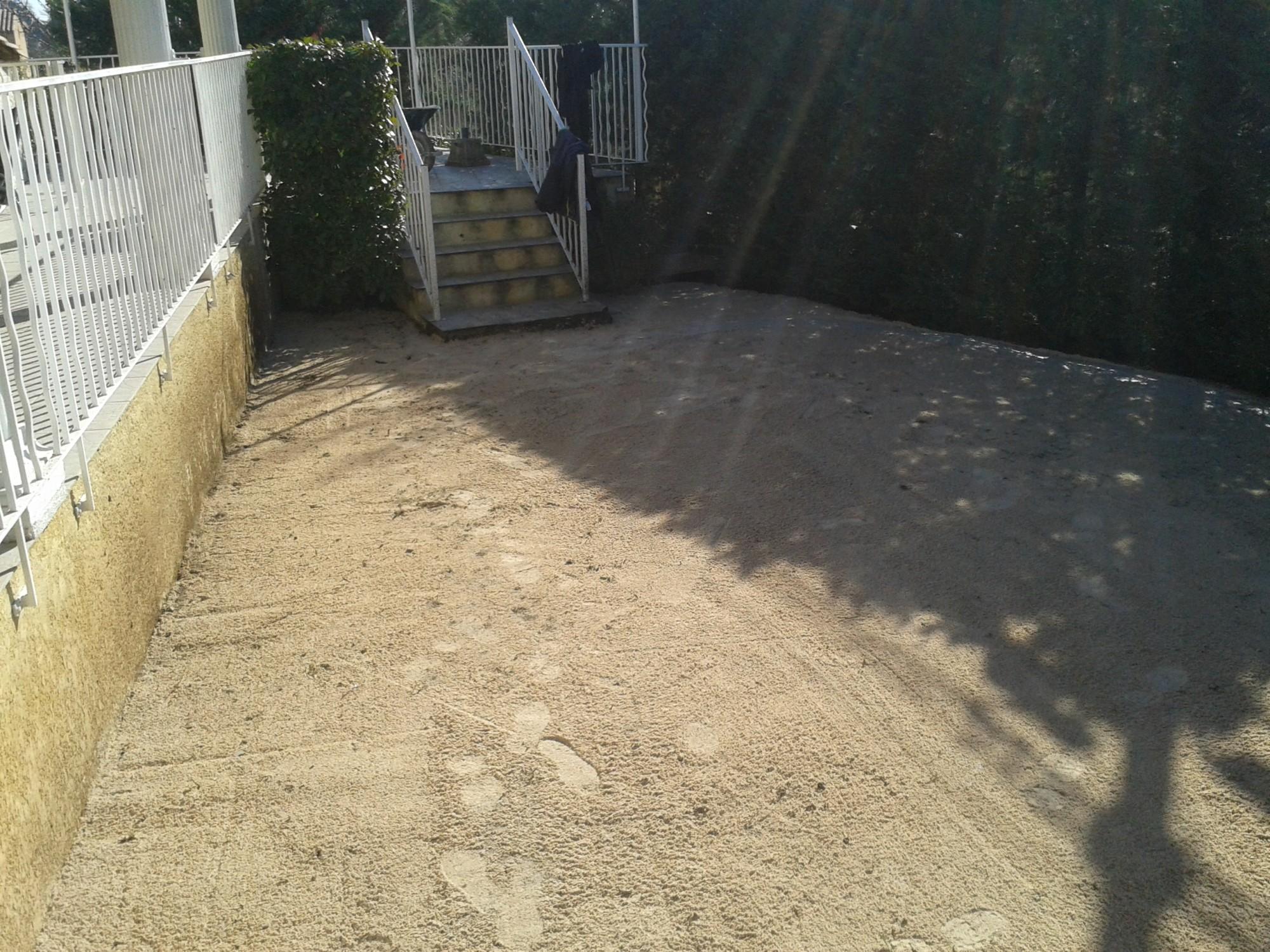 Mise en place du sable stabilisé